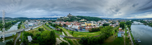 Photo sur Toile Con. Antique Aerial panorama of the Trencin Slovakia with the Vah river, bridges, castle, and medieval downtown