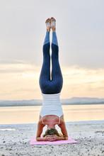 Woman Doing Hatha Yoga Headsta...