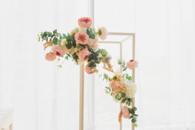 The Wooden Swing Decorated With Artificial Flowers.