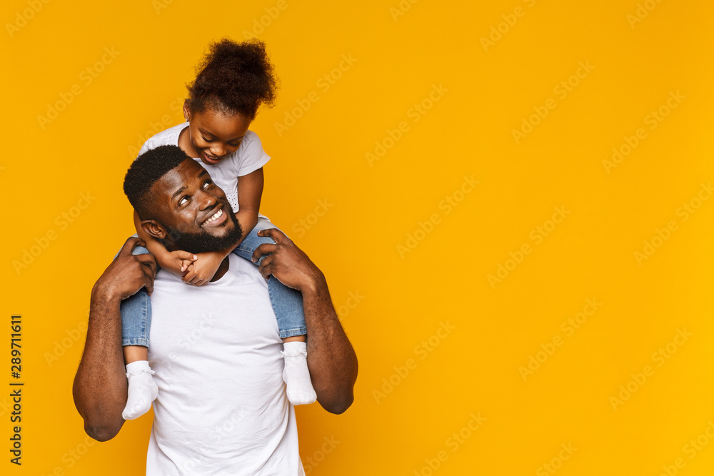 Fototapety, obrazy: Cute african girl sitting on daddy's shoulders