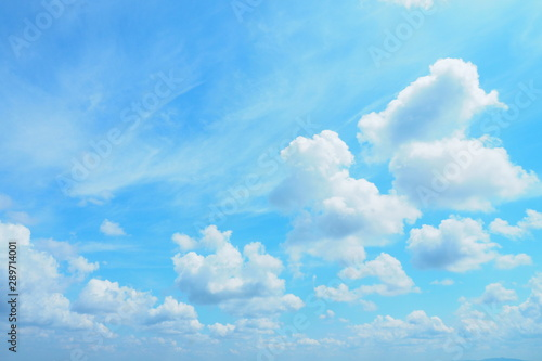 Beautiful bright blue sky and white clouds for cute background, wallpaper and decoration. Cool banner on page, presentation and website. Blue sky and clouds theme, inspirational and new day concept - 289714001