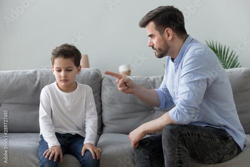 Fotografía Angry father scolding sad kid son for bad behavior