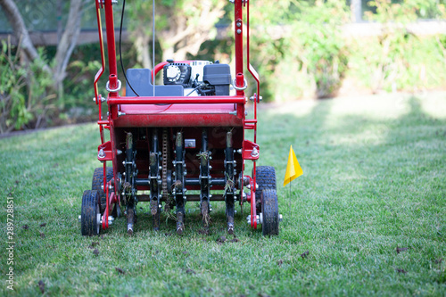 Red grass lawn aerator Wallpaper Mural