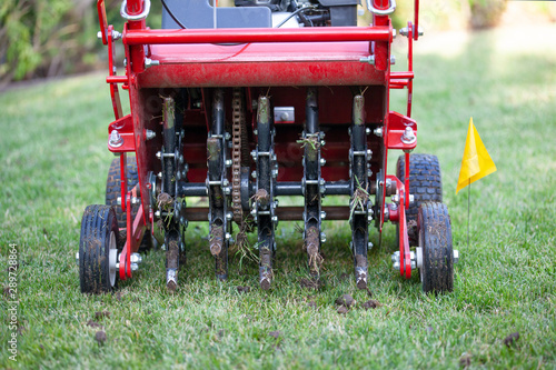 Photo Red grass lawn aerator
