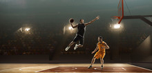 Two Basketball Players In Action Fighting For The Ball Near Hoop