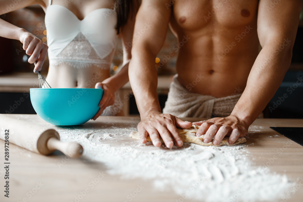 Fototapeta Young couple in underwear cooking on the kitchen