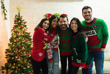 Cheerful Friends Enjoying Christmas Together At Home
