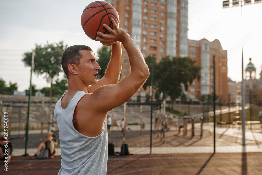 Fototapety, obrazy: Basketball player makes a throw on outdoor court