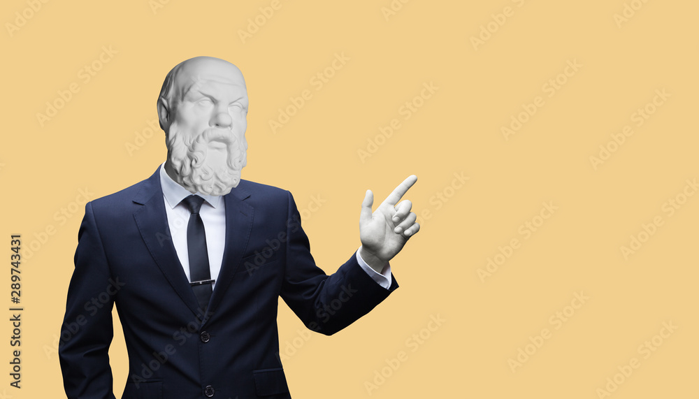 Fototapeta Modern art collage. Concepе зortrait of a  Modern art collage. Concept portrait of a  businessman pointing finger .Gypsum head of of Socrates. Man in suit.