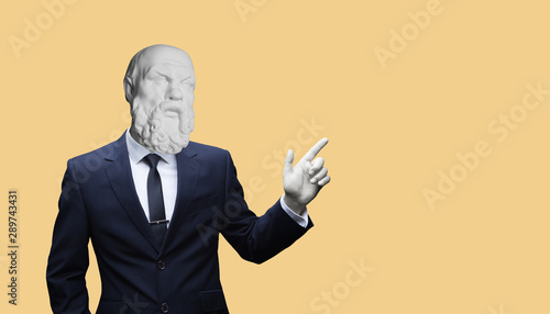 Obraz Modern art collage. Concepе зortrait of a  Modern art collage. Concept portrait of a  businessman pointing finger .Gypsum head of of Socrates. Man in suit. - fototapety do salonu