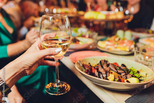 Close up shot of group of people clinking glasses with wine or champagne in front of bokeh background. older people hands - 289760618