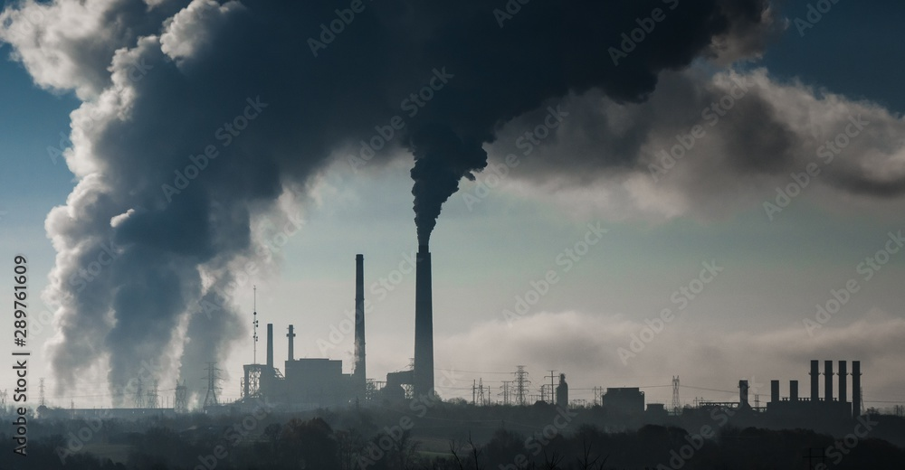 Fototapety, obrazy: Horizontal shot of smoke coming out of a power station polluting the air
