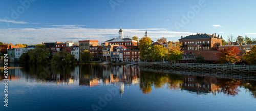 The river front buildings of Exeter, New Hampshire are seen reflected in the wat Fototapeta