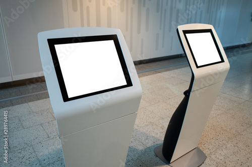 Blank white mock up template of two touch screen kiosk machines. Wallpaper Mural