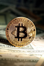 Shiny Bright Golden Bitcoin, Balanced On Piles Of Money. Wealth, Digital, Virtual, Currency, And Cryptocurrency Concept.
