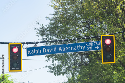 Road street direction sign for Ralph David Abernathy boulevard with traffic ligh Wallpaper Mural