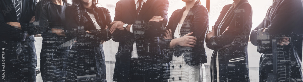 Fototapeta Business people group standing together with city office building background double exposure. Modern corporate job and human resources recruiting concept.
