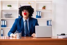 Young Clown Businessman Workin...