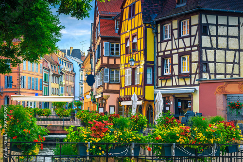 Beautiful antique half-timbered facades with decorated street, Colmar, France