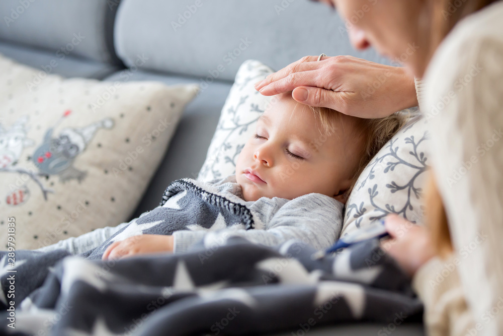 Fototapety, obrazy: Sick child, toddler boy lying in bed with a fever, resting at home