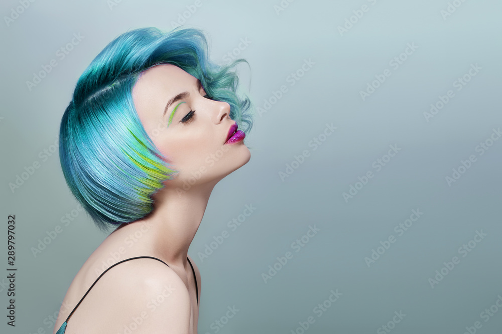 Fototapety, obrazy: Portrait of a woman with bright colored flying hair, all shades of blue purple. Hair coloring, beautiful lips and makeup. Hair fluttering in the wind. Sexy girl with short  hair. Professional coloring