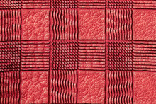 Texture Of Genuine Plaid Leather Close-up, Red Color. For Background, Copy Space