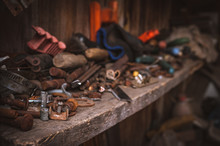 Perspective View Of A Messy Wooden Shelf In A Garage Workshop. Keeping Your Workspace Clean And Tidy Concept.