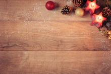 Christmas Background With Red Candles, Golden Cones And Sparkle Balls. Top View, Flat Lay. Winter Holidays Wooden Backdrop With Copy Space For Text