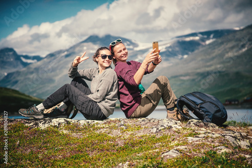 Photo  Two beautiful young girlfriends travel together in Norway, adventure, hiking, li