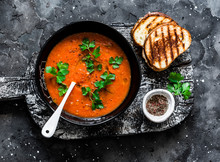 Baked Tomato Soup And Grilled Cheese Hot Sandwiches On Dark Background, Top View. Vegetarian Food Diet Concept