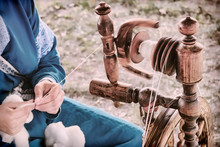 Vintage Distaff Creates Threads From A Spindle. Hand Retro Spinning Wheel In Nature, Lifestyle.