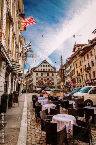 Old town street and restarurant tables in Lucerne city, Switzerland Canvas