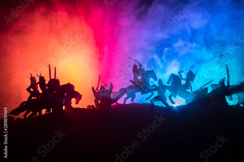 Naklejki historyczne medieval-battle-scene-with-cavalry-and-infantry-silhouettes-of-figures-as-separate-objects-fight-between-warriors-on-dark-toned-foggy-background-with-medieval-castle