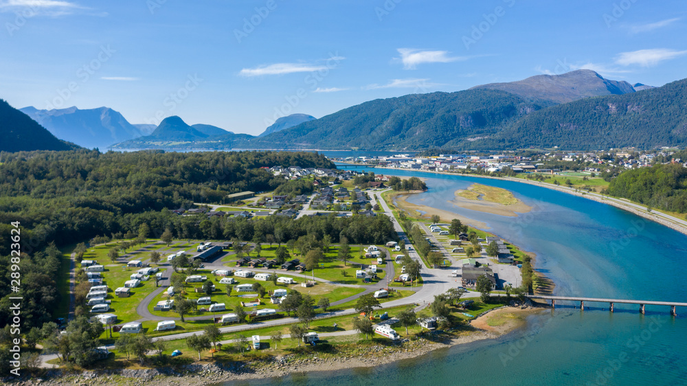 Fototapeta Beautiful Nature Norway natural landscape. Aerial view of the campsite to relax. Family vacation travel, holiday trip in motorhome.