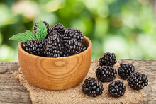 Blackberry In Bowl On The Wooden Table With Leaf Isolated On A White Background Closeup