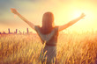 Leinwanddruck Bild - Happy autumn woman raising hands over sunset sky, enjoying life and nature. Beauty female on field looking on sun. Silhouette of girl in sunlight rays. Fresh air, environment concept. Dream of flying