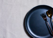 Empty plate with spoon and fork on Napery background, table setting