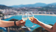 canvas print picture - Drink two glasses white wine in friend hand outdoor sea nature holiday, romantic couple toast alcohol, people cheer fun vacation enjoying travel time together friendship love concept congratulations