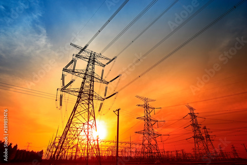 Fotografiet  Electric tower, silhouette at sunset