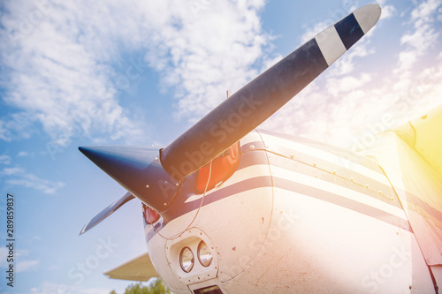 Fotografia, Obraz Close up airplane propeller with sun flare on sky background