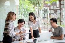 Young Asian Business Group Wit...