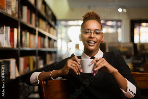 Black african american young yoman drinking coffee Canvas