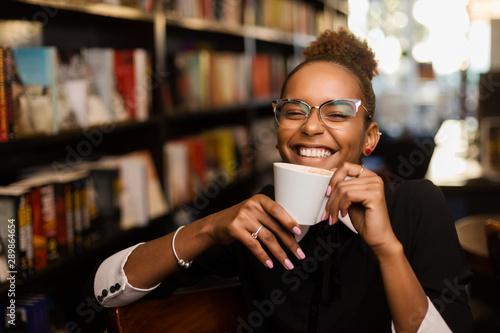 Fototapeta  Black african american young yoman drinking coffee