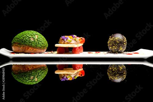Obraz na płótnie Dark chocolate egg with chou bun stuffed with chocolate cream