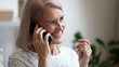 canvas print picture Happy beautiful mature woman making phone call close up