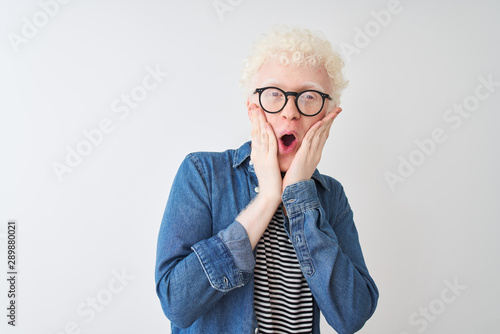 Fototapeta  Young albino blond man wearing denim shirt and glasses over isolated white backg