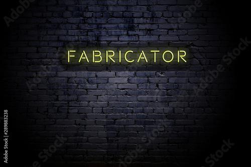 Obraz na plátně Highlighted brick wall with neon inscription fabricator