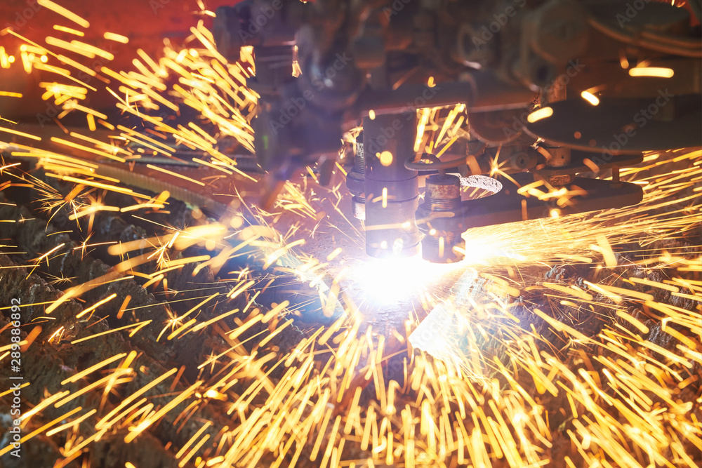 Fototapety, obrazy: Gas plasma cutting. Metal machining with sparks on CNC maching