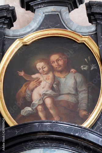 Obraz na plátne Saint Joseph with child Jesus, altarpiece in the church of St