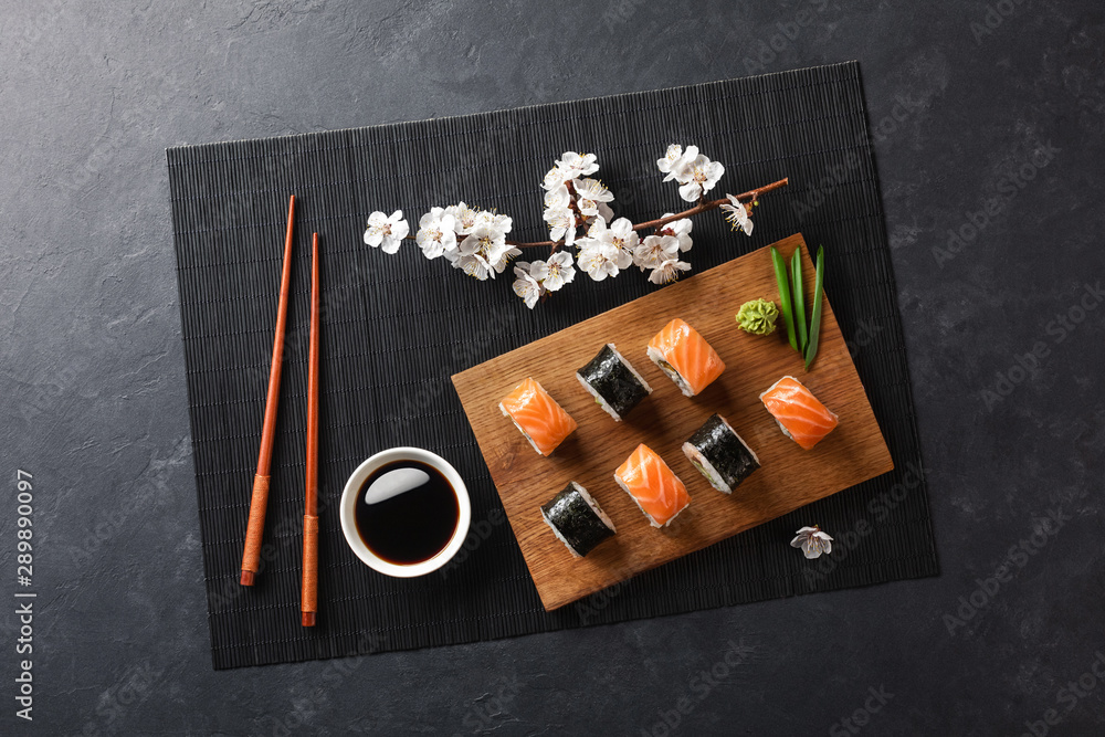 Fototapety, obrazy: Set of sushi and maki rolls with branch of white flowers on stone table